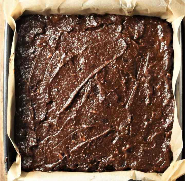 Unbaked brownies cake in square pan.