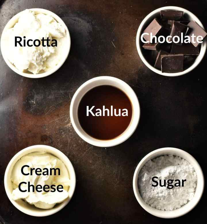 Kahlua cheesecake pots ingredients in individual dishes.