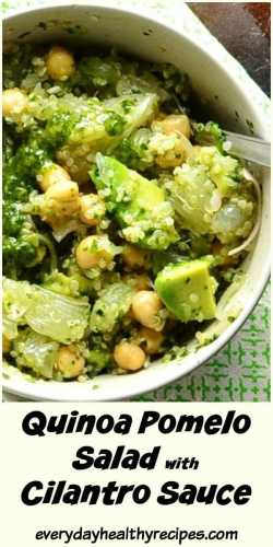Top down partial view of quinoa salad with avocado, chickpeas and green sauce inside white bowl on top of green cloth.