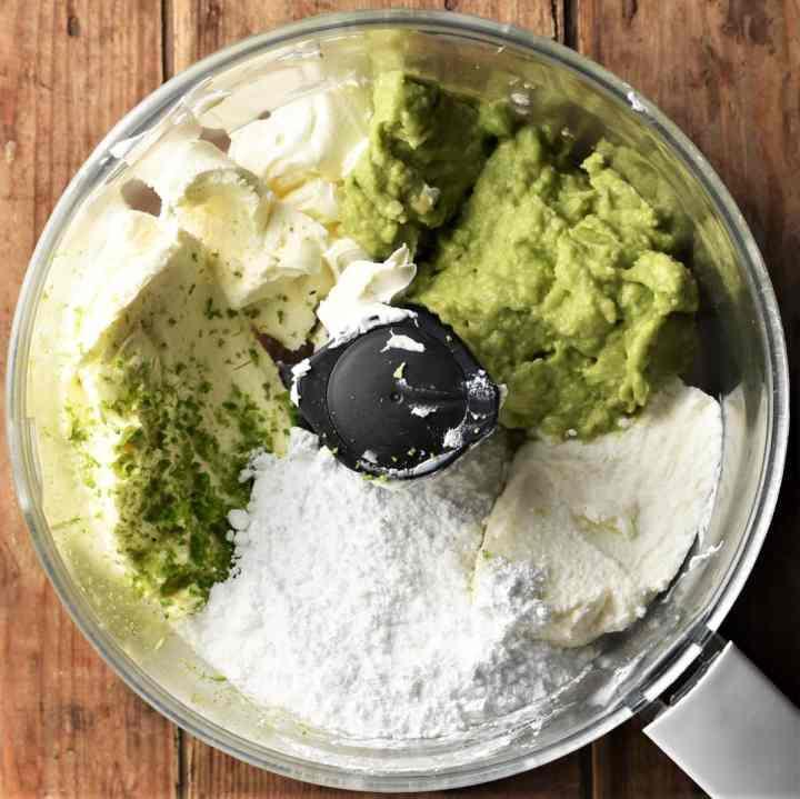 Making avocado cheesecake filling in food processor.