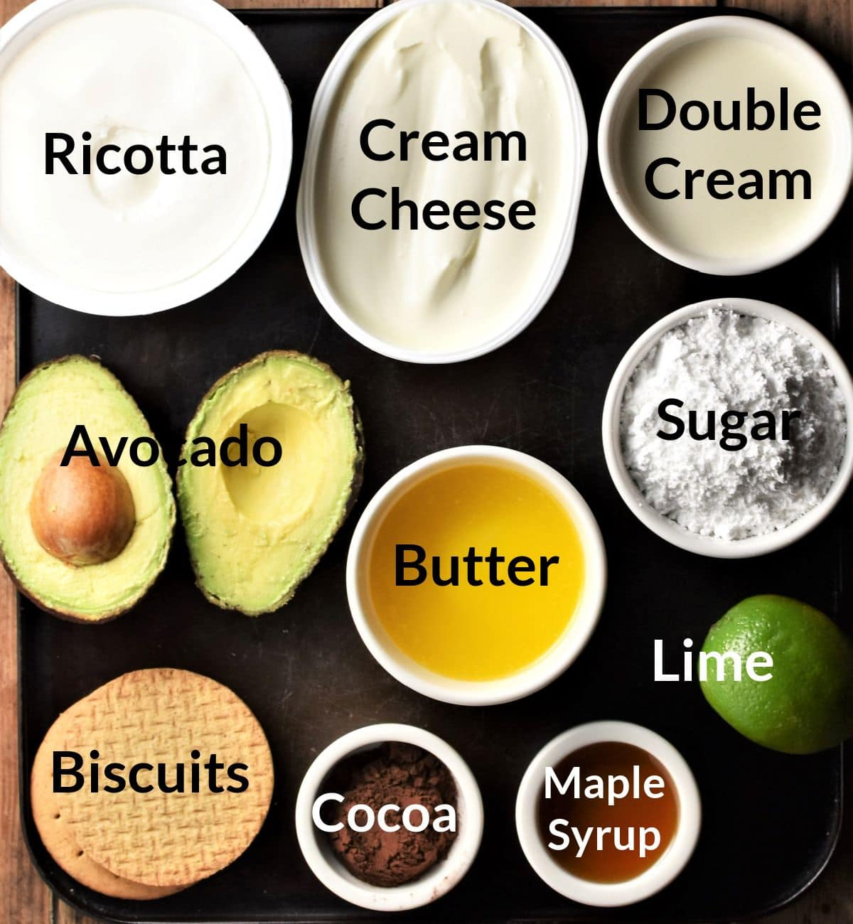 Ingredients for making avocado cheesecake in individual dishes.