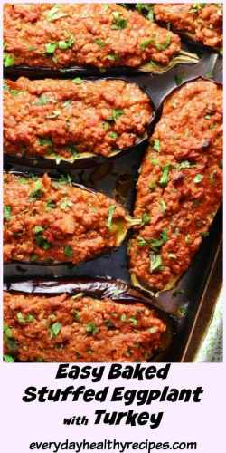 Top down view of 4 baked stuffed eggplant halves on top of dark tray.