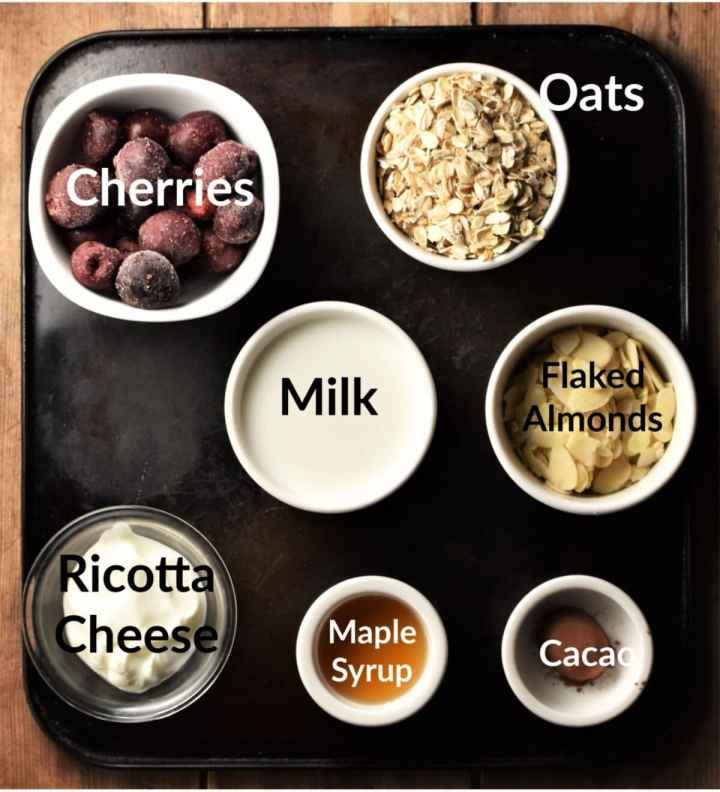 Cherry overnight oats ingredients in individual dishes.