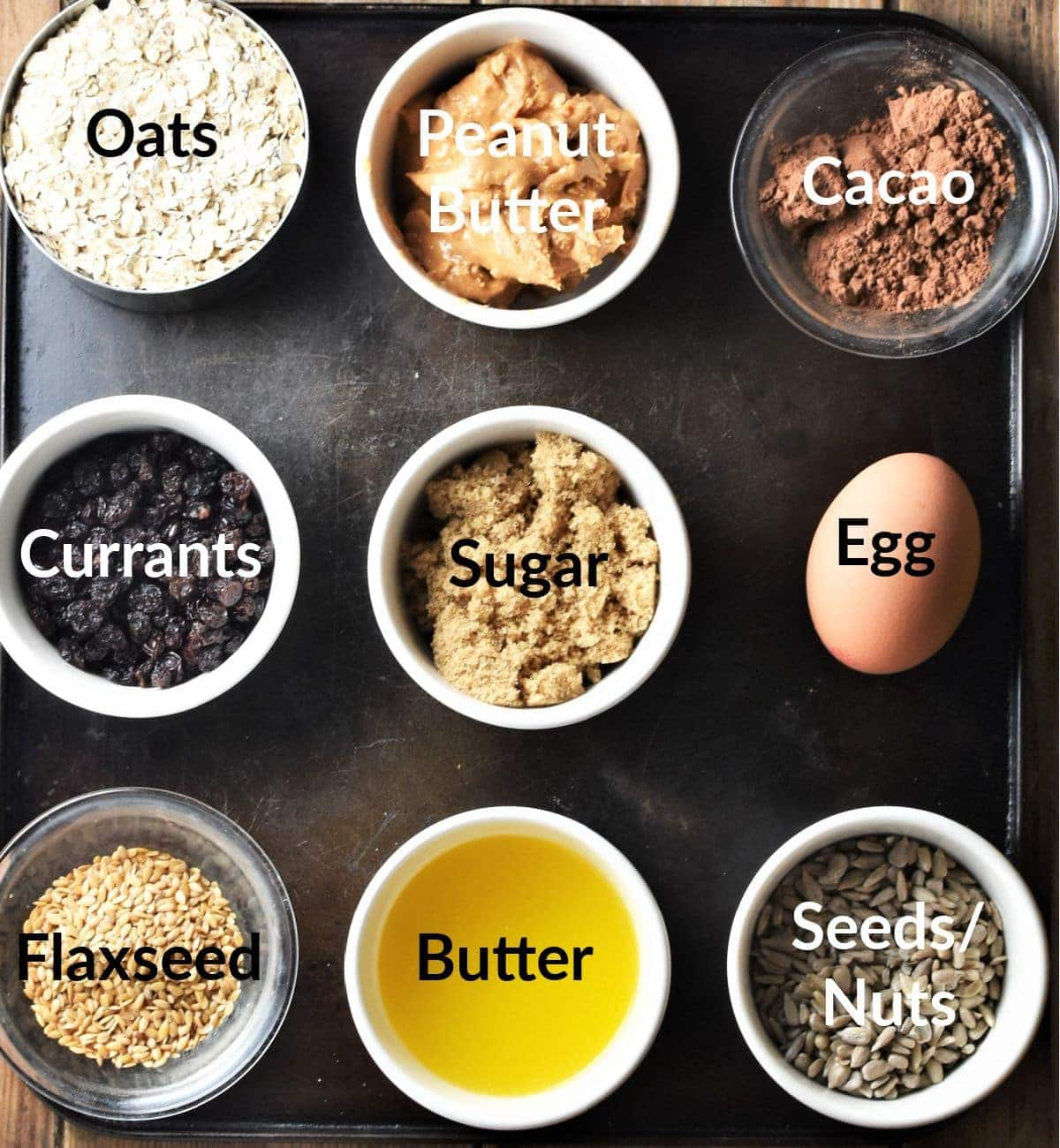 Healthy chocolate oatmeal cookies ingredients in individual dishes.