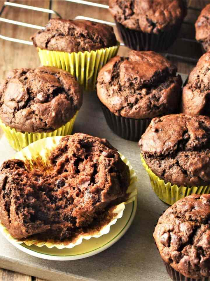 Side view of pumpkin chocolate muffins in yellow liners.