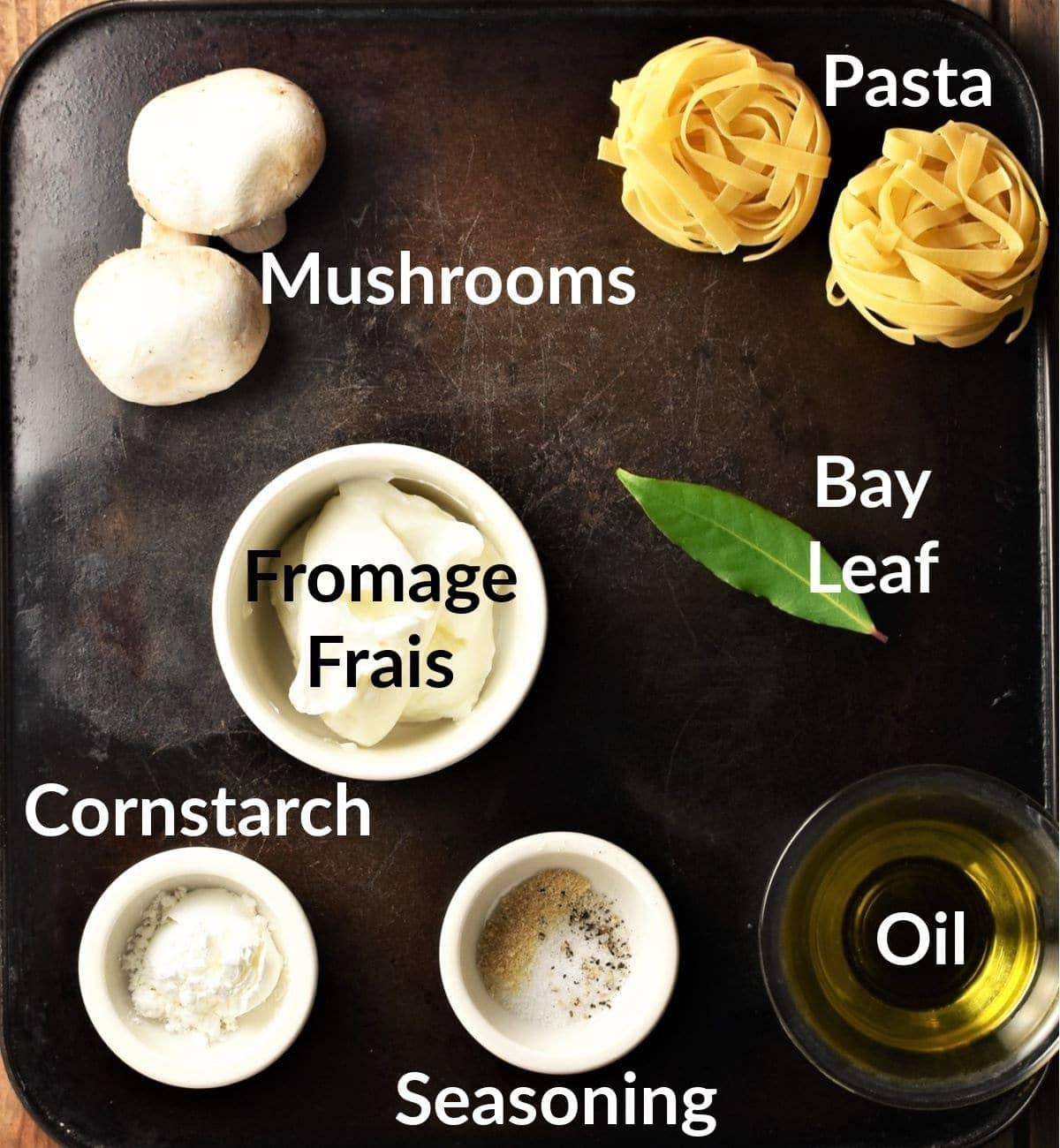 Mushroom pasta ingredients in individual dishes.