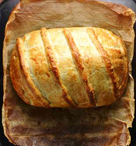 Turkey wellington on baking paper.