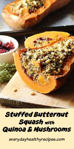 Side view of stuffed butternut squash with dried cranberries in white dish and thyme in background.