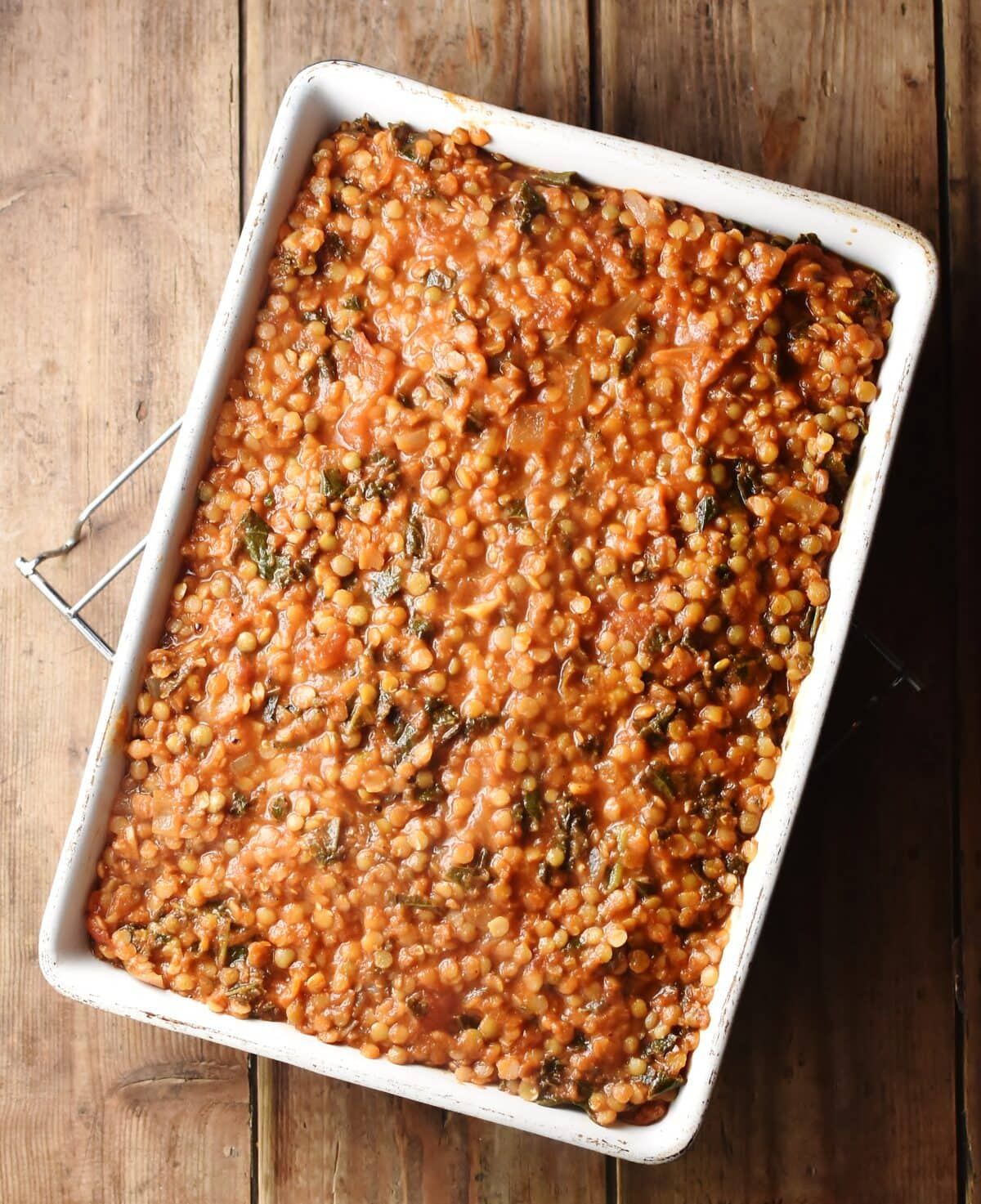Lentil and tomato mixture in rectangular white dish.