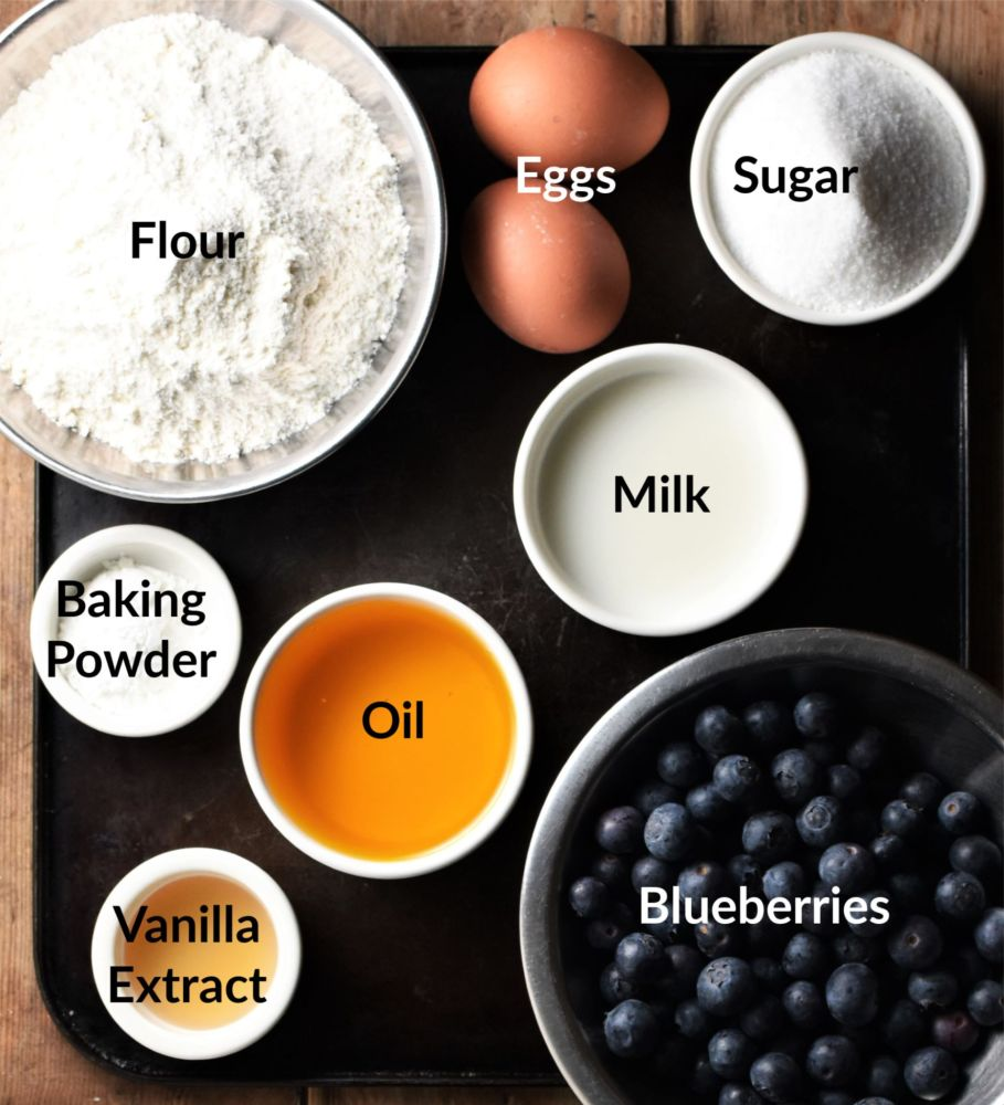 Blueberry cake ingredients in separate dishes.
