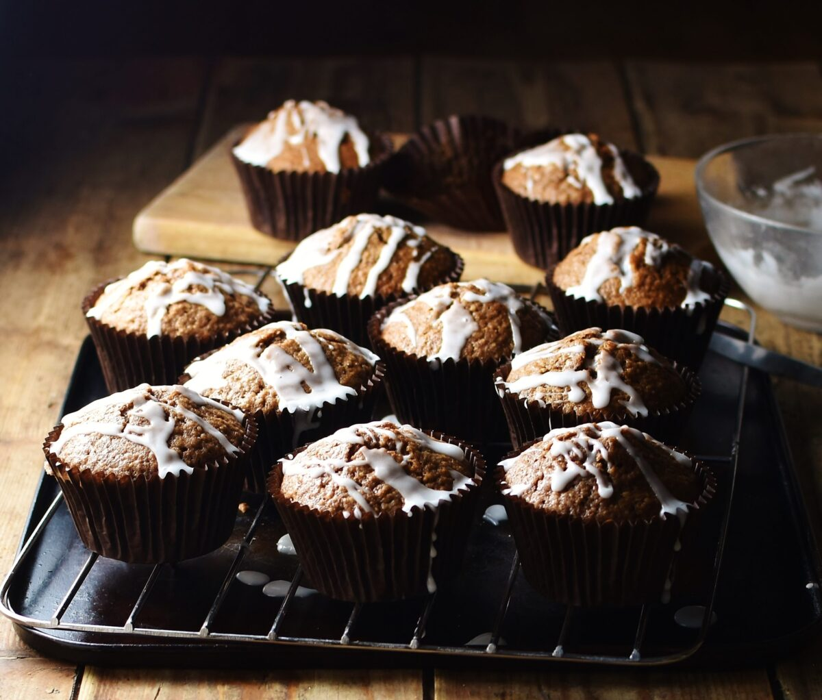 Side view of gingerbread muffins on top of rack and tray.