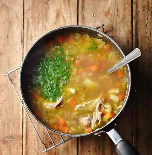 Chunky turkey soup with vegetables and herbs.