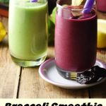 Side view of purple and green smoothies in glasses with purple straws.