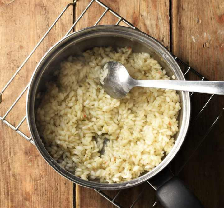 Rice in saucepan with spoon.
