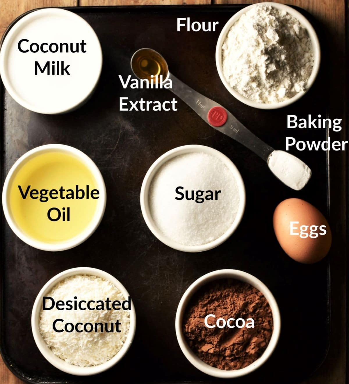 Ingredients for chocolate coconut cake in individual dishes.