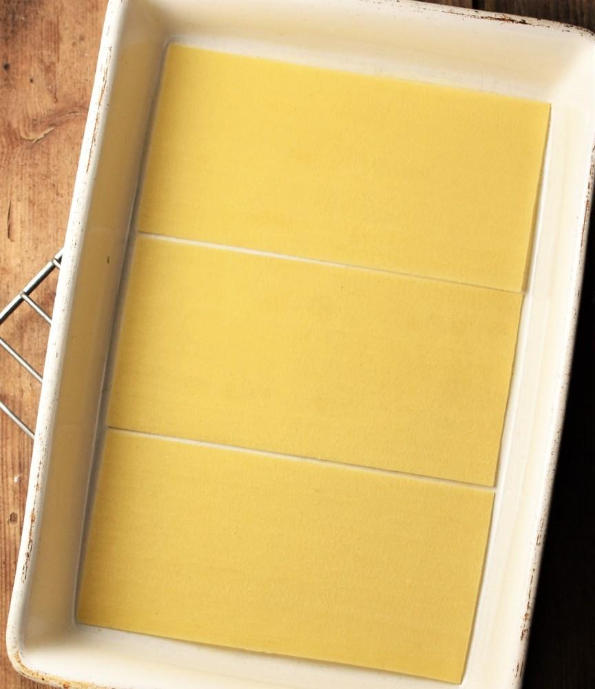 Top down view of lasagna sheets inside dish.