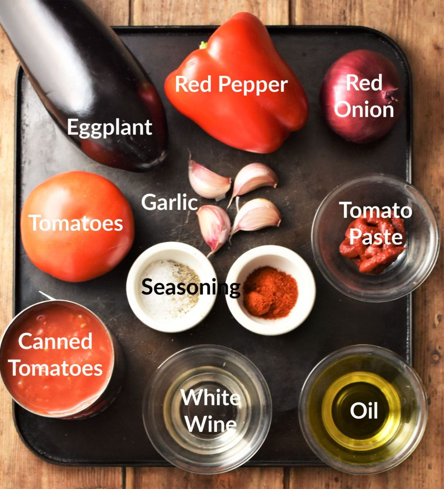 Eggplant tomato sauce ingredients in individual dishes.