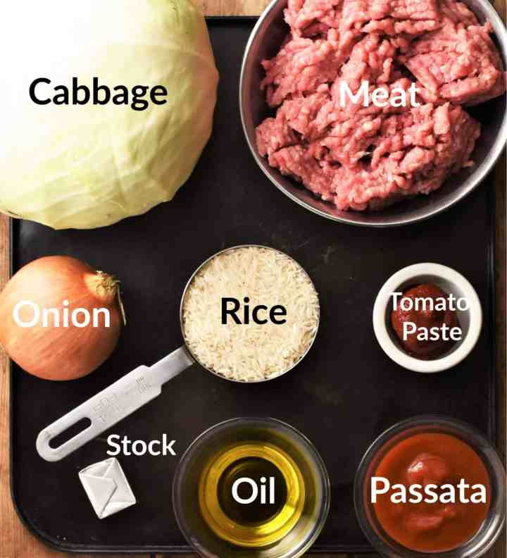 Cabbage rolls ingredients in individual dishes.