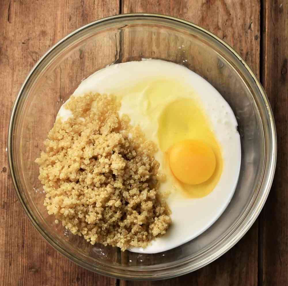 Buttermilk, egg and cooked quinoa in mixing bowl.