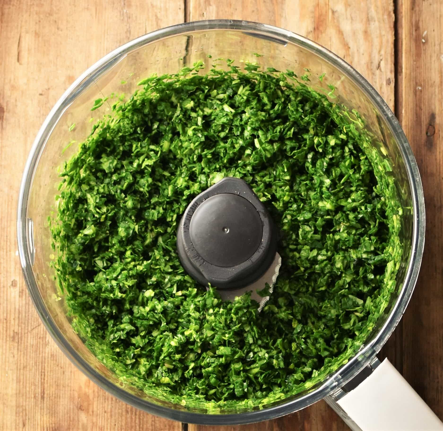 Chopped spinach mixture in blender.