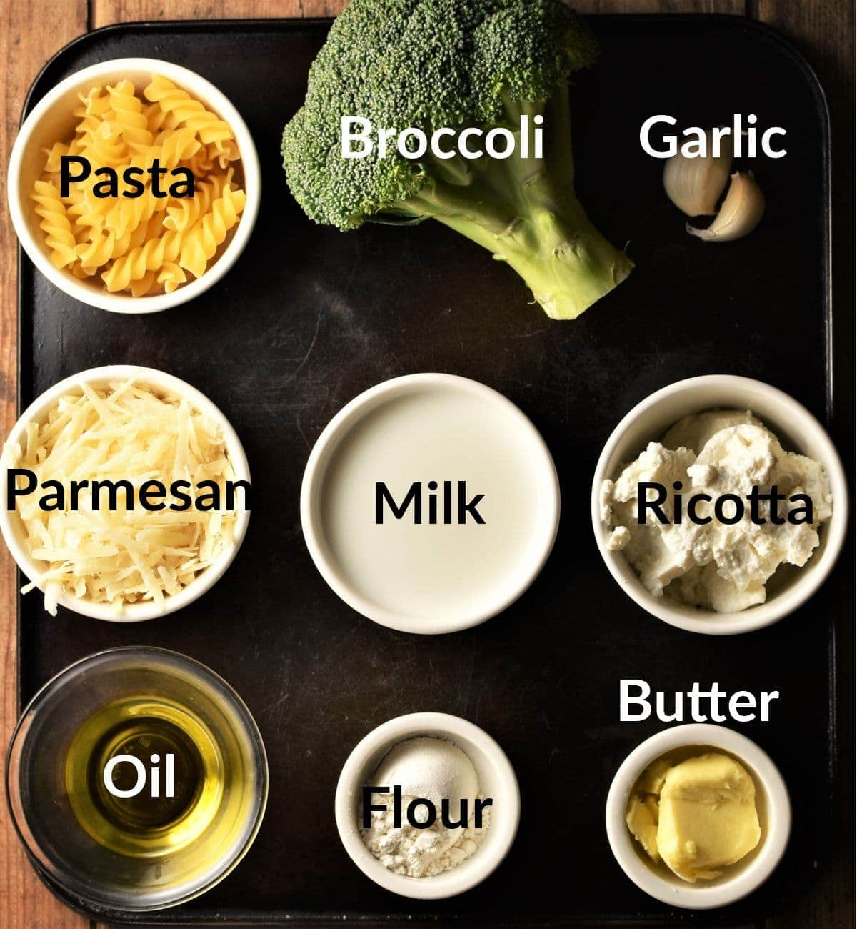 Pasta and broccoli recipe ingredients in individual dishes.