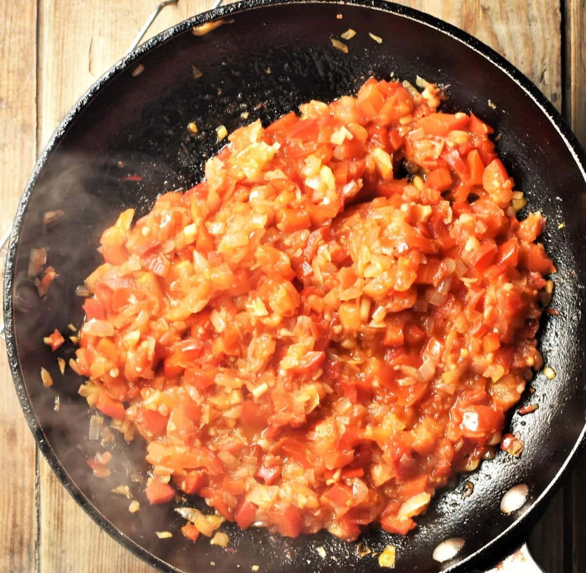 Tomato red pepper sauce in large pan.