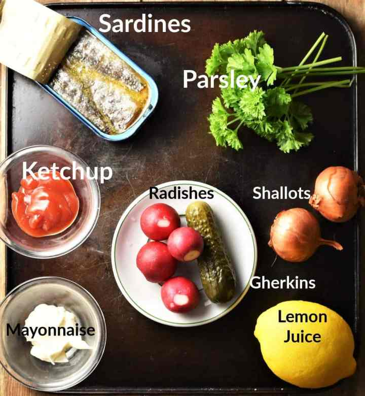 Ingredients for sardines on toast in individual dishes.