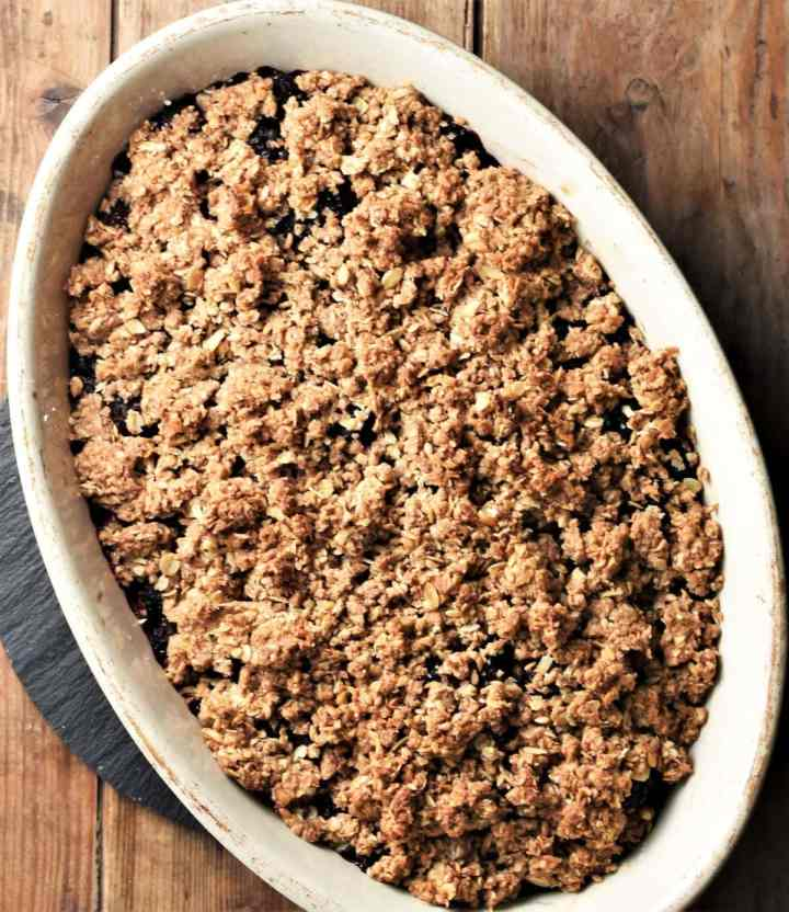 Top down view of crumble in oval white dish.