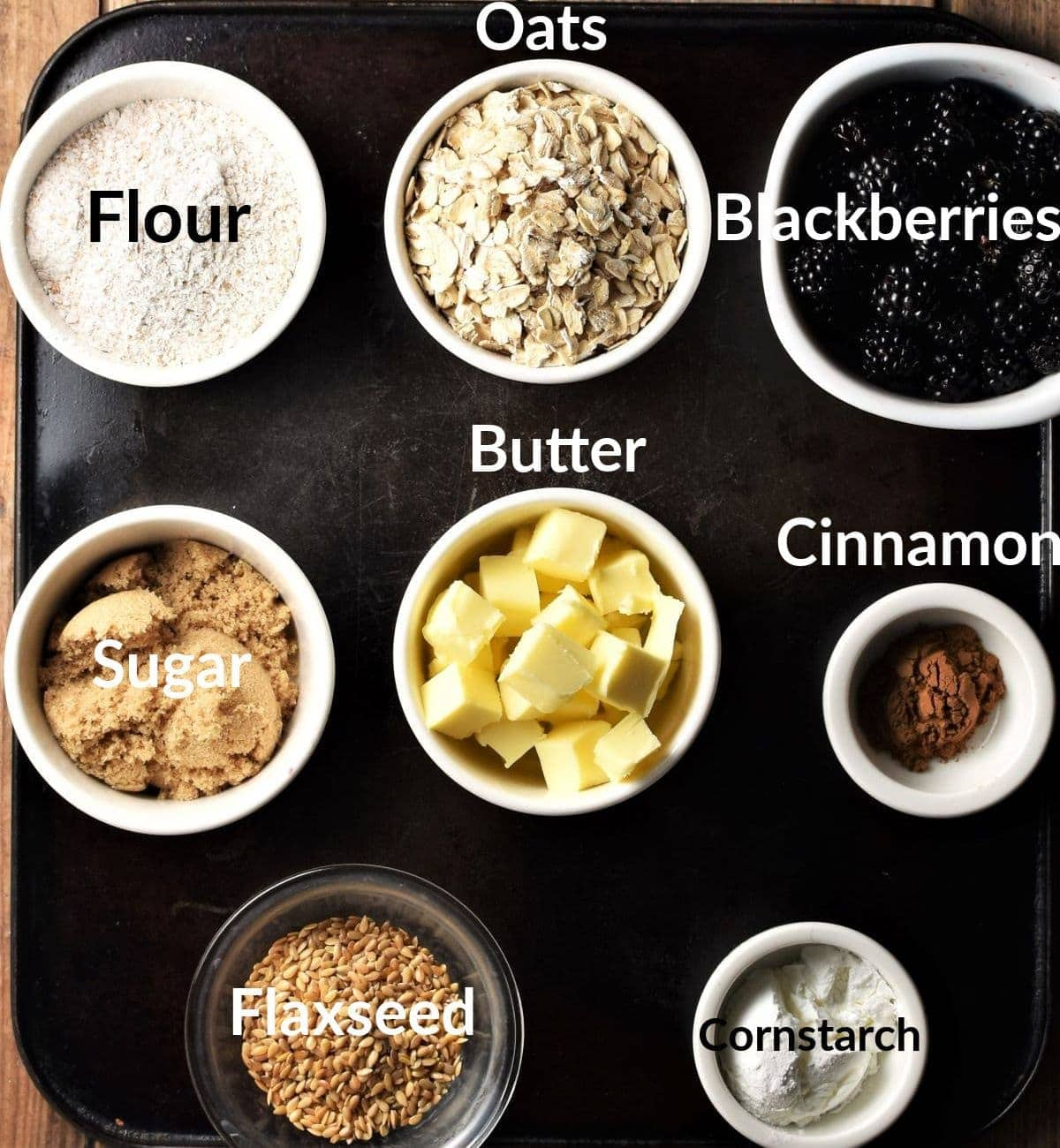 Blackberry crumble ingredients in individual dishes.