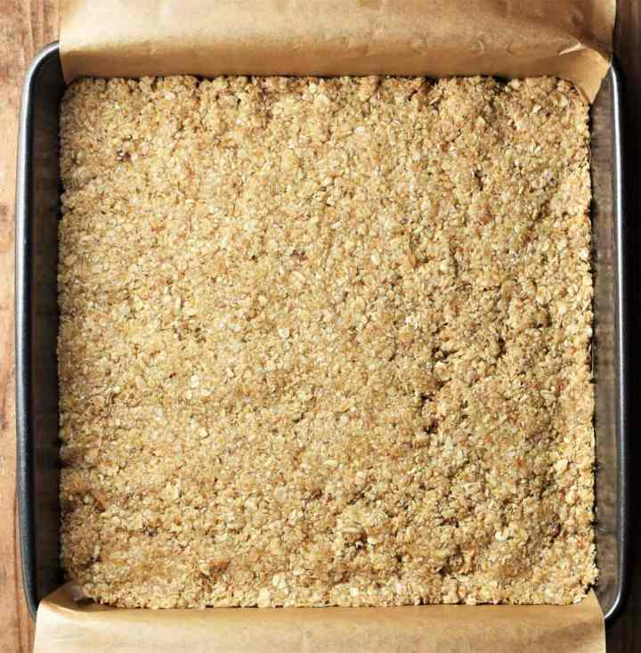 Oat base in square pan lined with parchment.