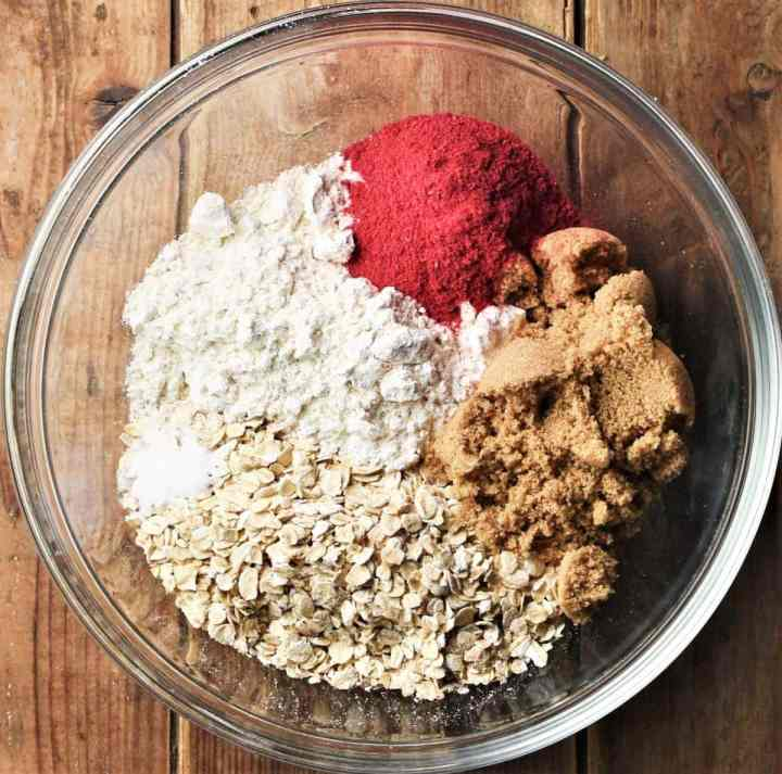 Oats, flour, sugar and raspberry powder in mixing bowl.