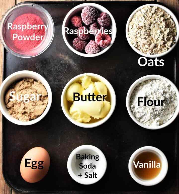 Raspberry cookies ingredients in individual dishes.
