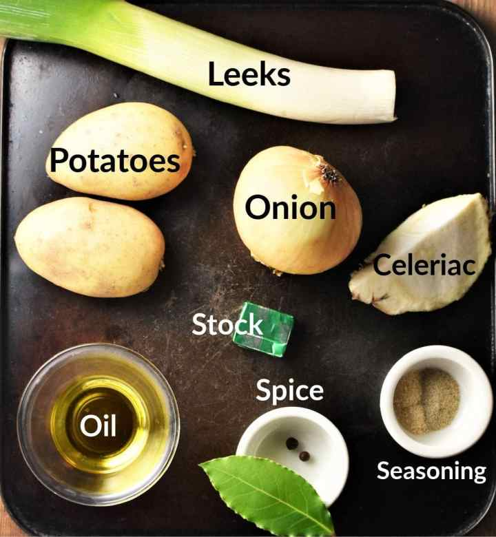 Chunky leek and potato soup ingredients in individual dishes.