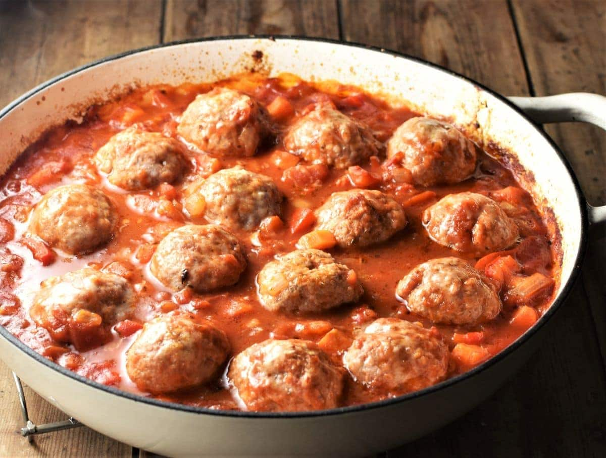 Meatball vegetable casserole in white shallow dish.