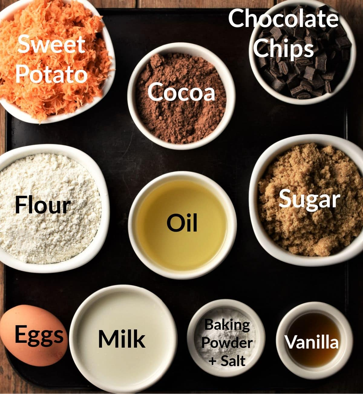 Sweet potato chocolate muffins ingredients in individual dishes.