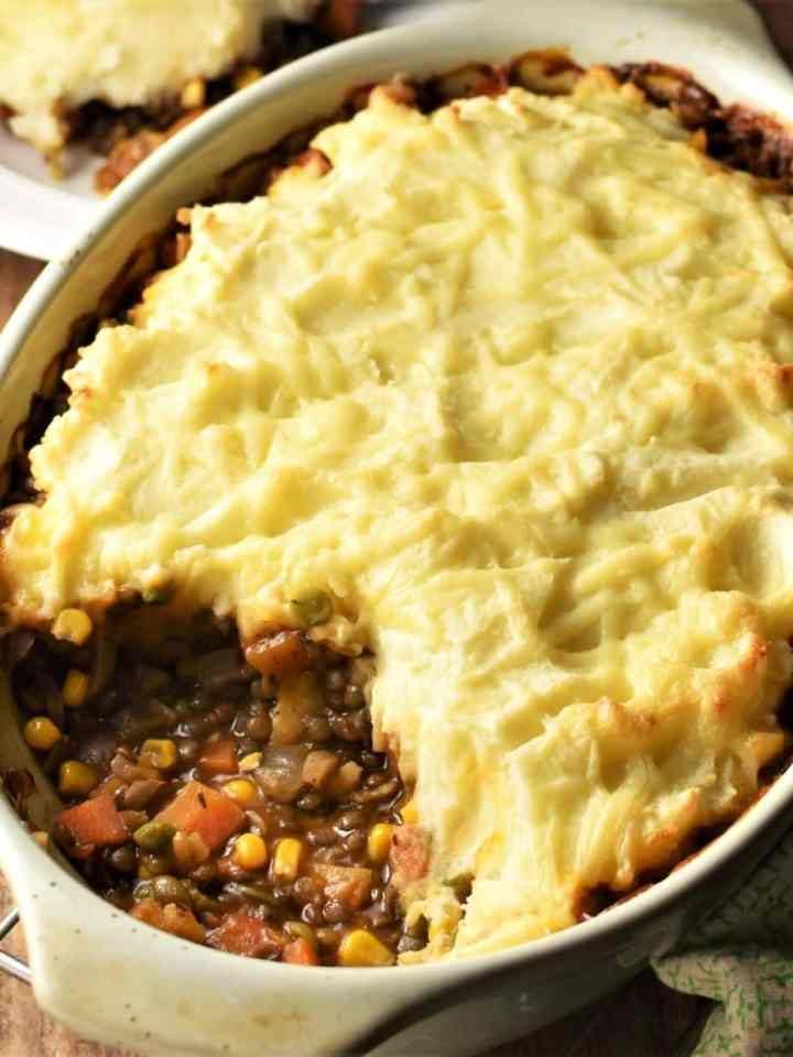 Lentil and vegetable shepherd's pie in oval dish.
