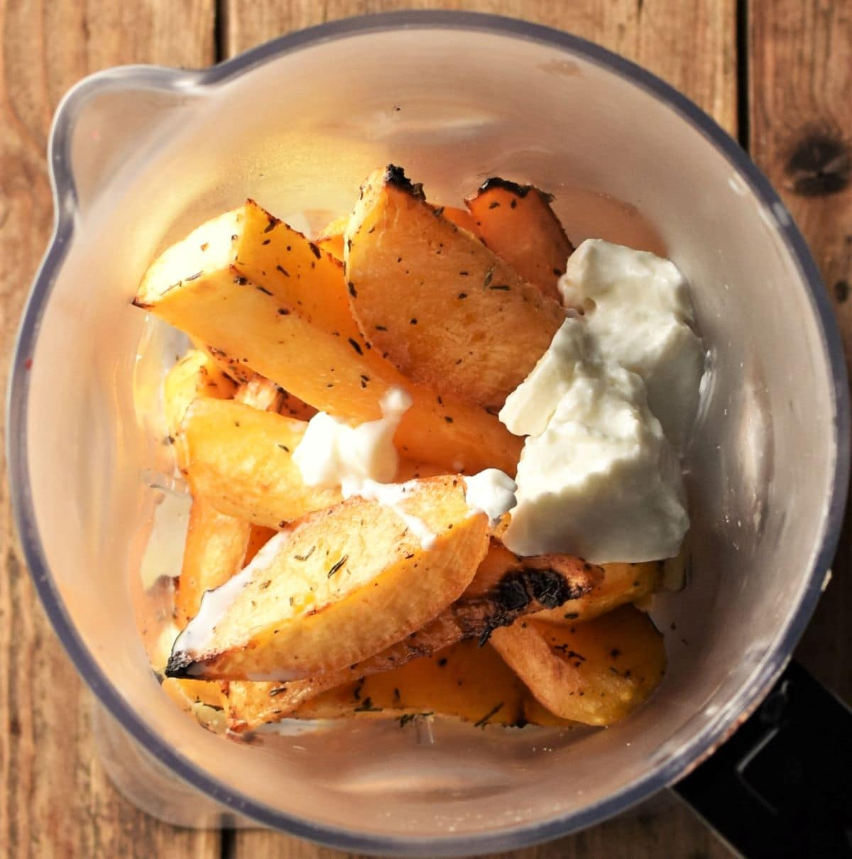 Rutabaga wedges with yogurt in blender.