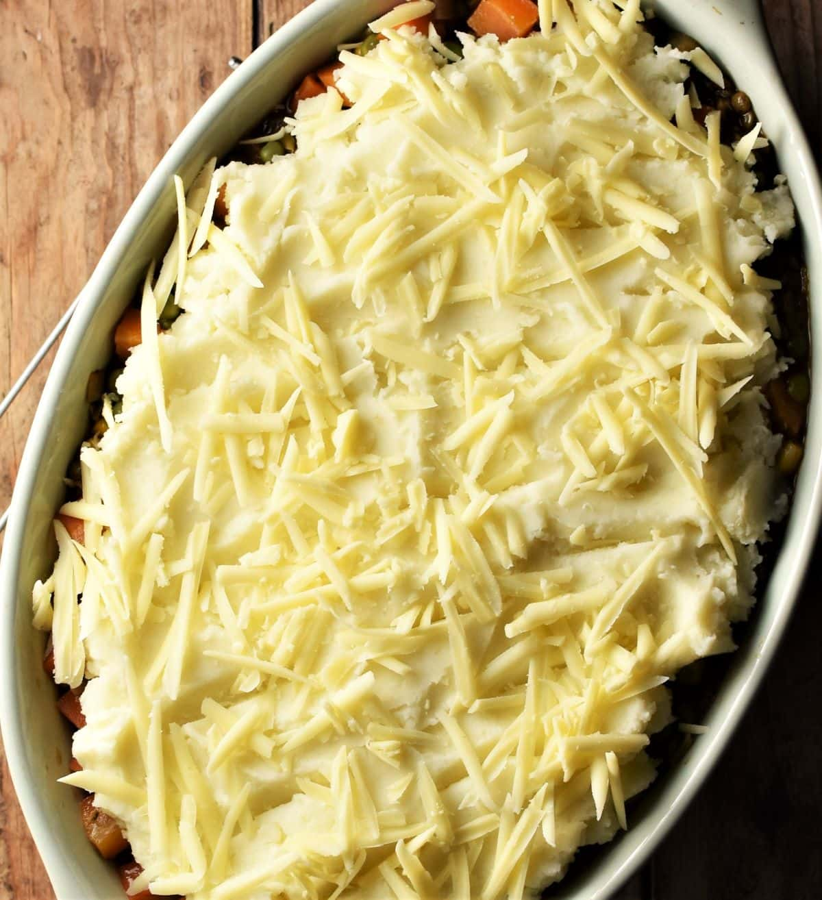 Shepherd's pie with potato topping and scatter of grated cheese.