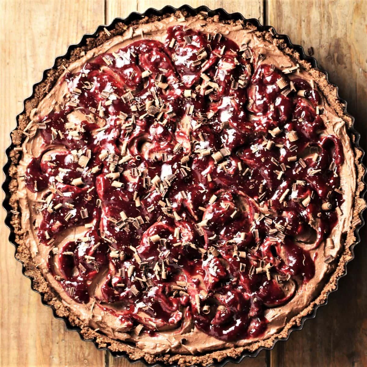 Black forest cheesecake tart in round tin.