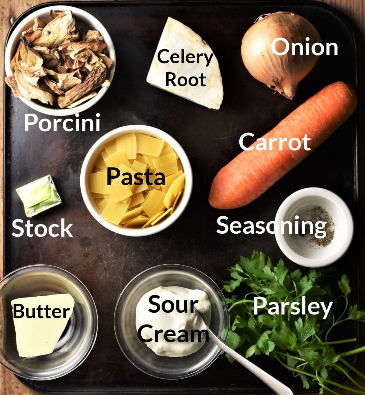 Polish mushroom soup ingredients in individual dishes.