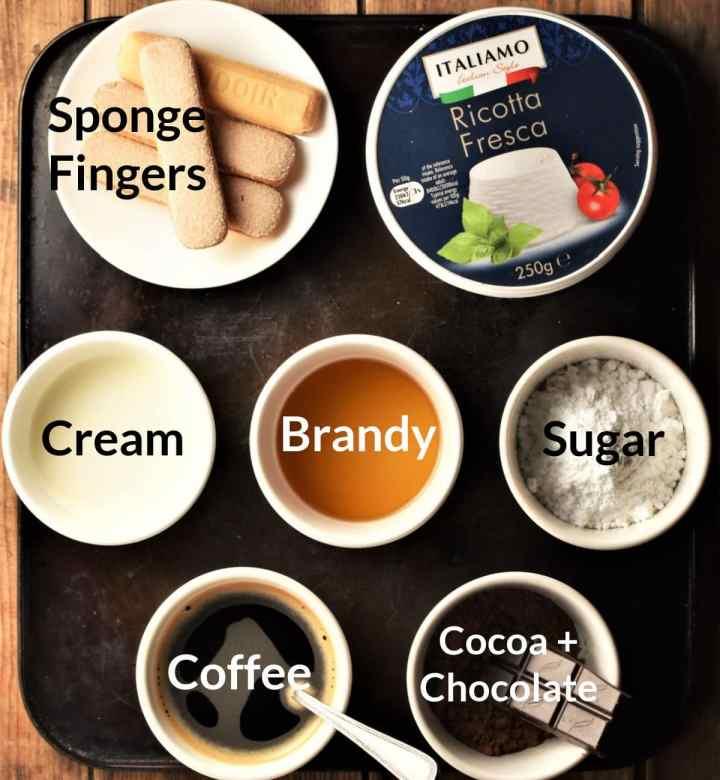 Ingredients for making tiramisu cups in individual dishes.