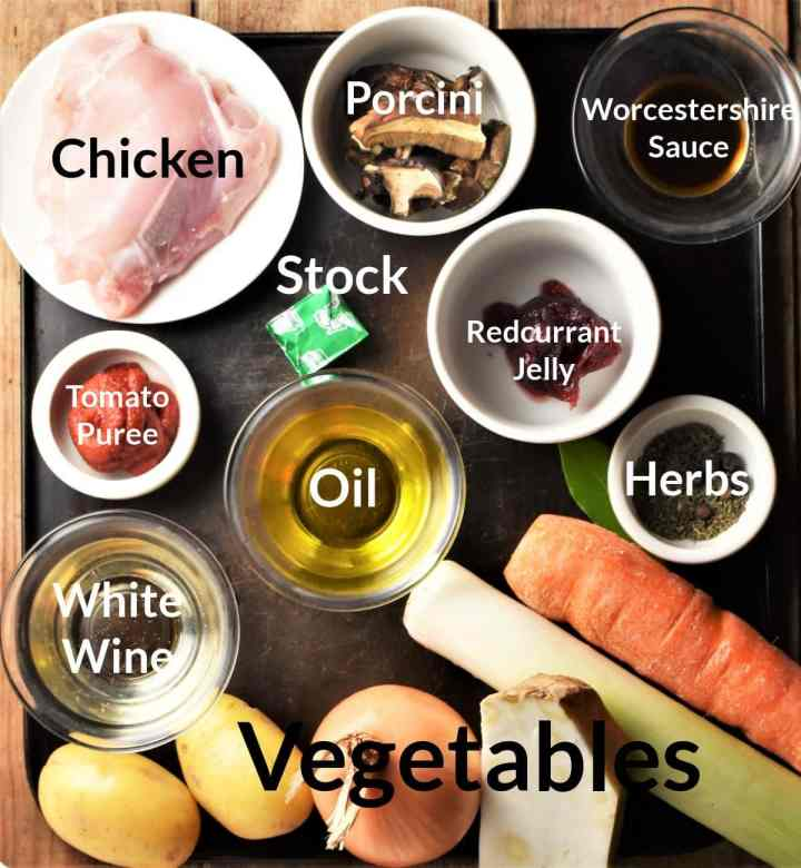Ingredients for making chicken stew with potatoes displayed in individual dishes.