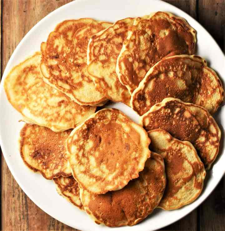 Pancakes arranged on top of large plate.