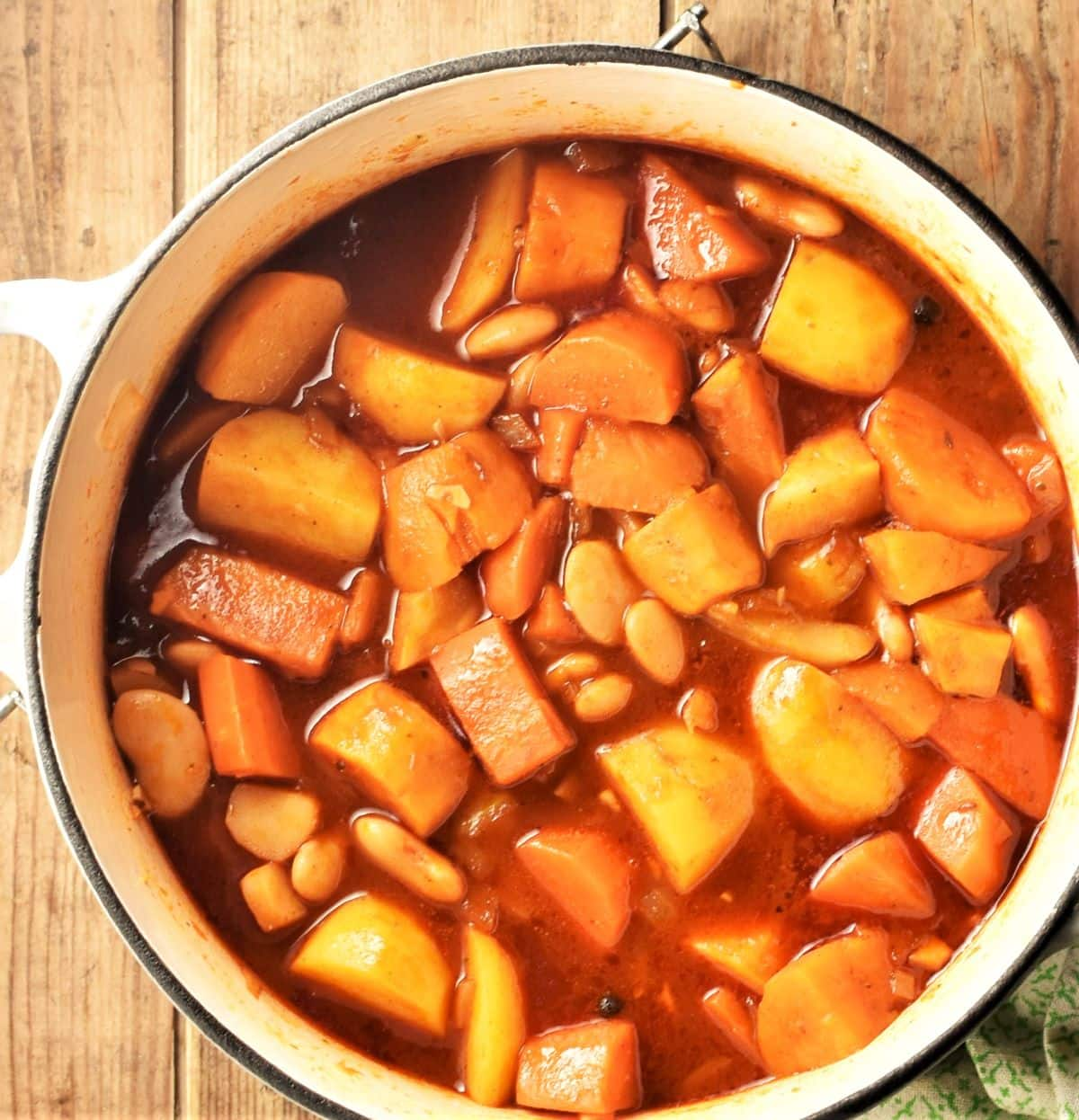 Cooking root vegetable casserole in large pot.