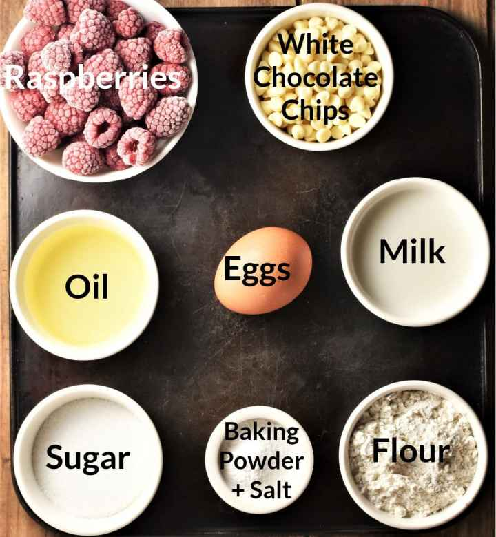 Ingredients for making raspberry white chocolate muffins in individual dishes.