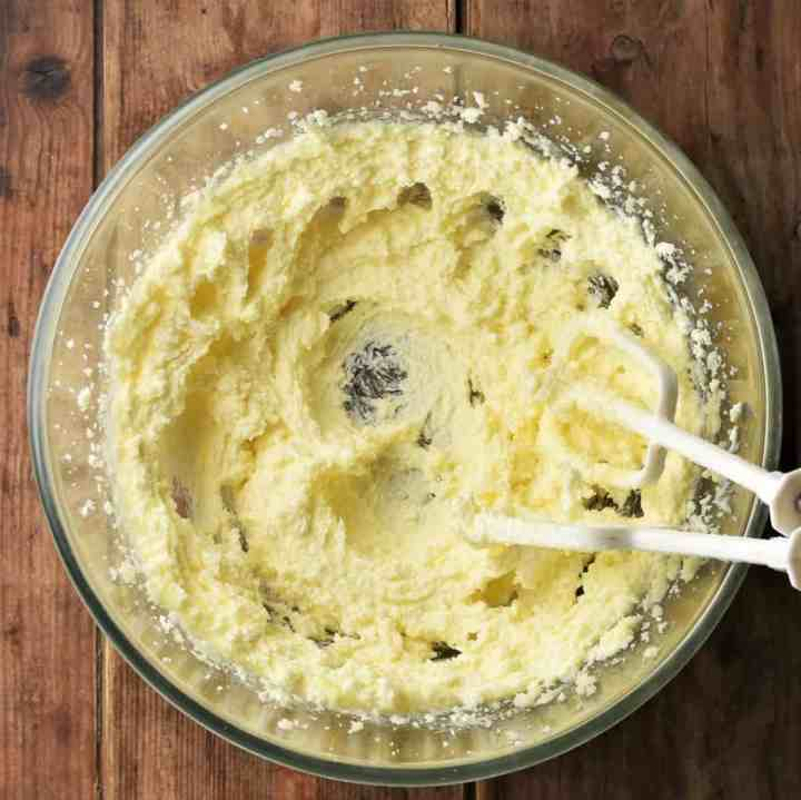 Fluffy butter mixture in large mixing bowl.