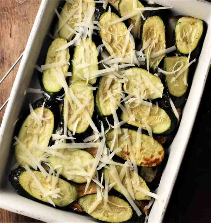 Layering moussaka with eggplant and zucchini slices.