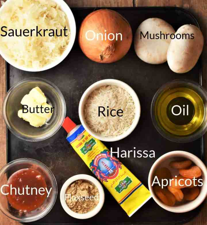 Ingredients for making filling mixture for sauerkraut cabbage rolls in individual dishes.