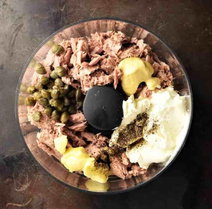 Top down view of tuna pate ingredients in food processor bowl.