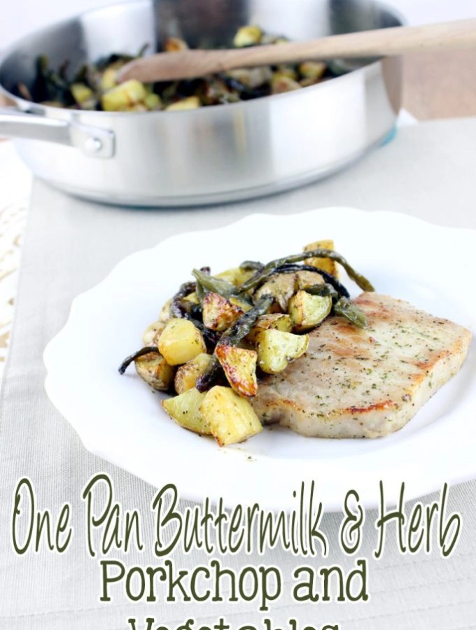Creamy buttermilk, garlic, and herbs top juicy pork chops and vegetables to create the perfect One Pan Buttermilk and Herb Pork Chop and Vegetables. | EverydayMadeFresh.com